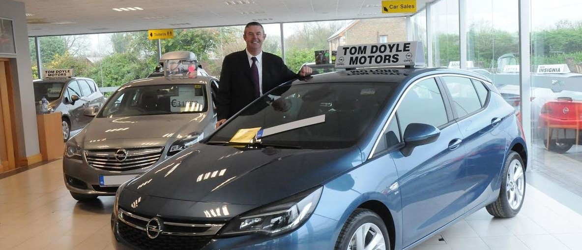 Tom Doyle Motors showroom with Tom Doyle